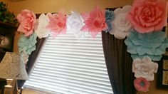 90th Birthday Party: Dessert table paper flowers backdrop.