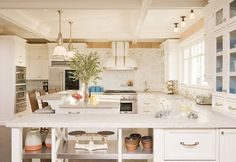 Kitchen - love the large island with the u-shape wrap around counters.  Great work space.  A few tweaks and it would be perfect!!