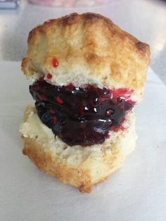 Homemade mini scone with homemade mixed summer berry jam.