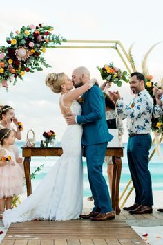Thinking about getting married in Cancun? Let Vickie and Daniel's tropical celebrations inspire your big day. Click for venue, decor and outfit details!  Photo credit: Cristina Gisselle Gonzalez Flores