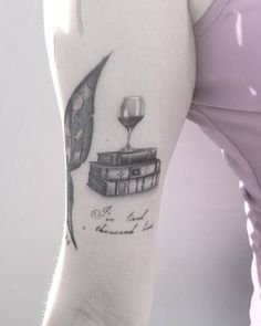A reader life's a thousand lives before she dies tattoo #wine #books #reading #tattoo