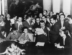 The Italian Minister of the Interior Giuseppe Romita reading in Viminal Palace the provisional results of the institutional referendum; behind him the young journalist Lello Bersani. Rome, 5th June 1946 MONDADORI PORTFOLIO