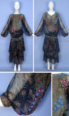 Chiffon dress, ca. 1928. Dark blue silk with a muted pattern of pink and blue floral bouquets, long sleeves gathered into cuff, blouson bodice, dropped waist, tiered skirt with scalloped hem dipping in the back, decorated with pink, blue and green floral beadwork, silk lining. Whitaker Auctions/LiveAuctioneers