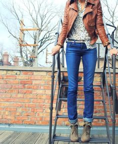 boots, jeans rolled up, belt, polka-dot shirt, and brown leather jacket