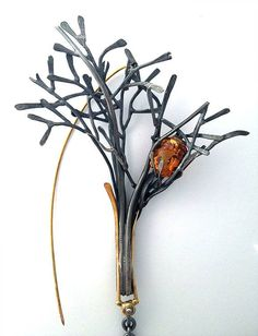 Brooch in 18k gold and sterling silver with citrine by Curtis Arima. Channels are carved in the branches to hold the stone in place.
