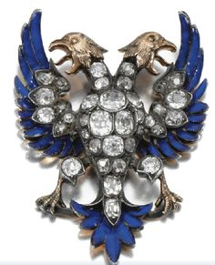 A double-headed eagle brooch in bright blue enamel and diamonds, late 19th century.