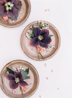 Moody purple boutonnieres: Photography : Kayla Barker Fine Art Photography Read More on SMP: http://www.stylemepretty.com/2016/07/21/terracotta-pink-take-center-stage-in-an-organic-wedding-inspo/