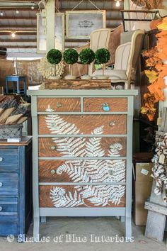 Hand painted fern design on natural wood with a gray body, and 4 boxwood topiaries on top.