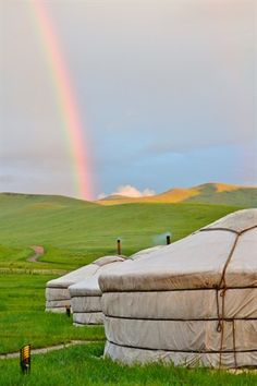 A #rainbow arches over the yurts in Mongolia
