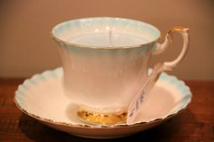 Tea Cup Candle Blue and Gold accentsClean Cotton by TrinketsDelRay, $16.99 Looks as if the cup and saucer were dipped in blue and gold.