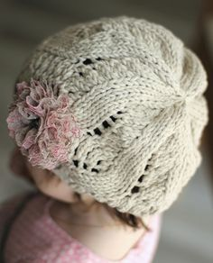It is a KNITTING PATTERN so that you can make the item yourself with your own choice of yarn and color. NOTE: Patterns are a final sale, due to their digital nature they cannot be returned or refunded. This pattern is available in ENGLISH and FRENCH (you will get 2 PDF files when buying the pattern). Refined and ladylike, this pretty slouchy hat embellished with a vintage lace flower and knitted in a soft cotton is a perfect accessory to shield you from the summer sun or warm you a bit on…