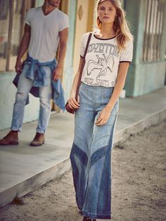 Tidal Wave Extreme Novelty Flare | Inspired by decades past, these high waisted wide leg jeans feature exposed seaming and contrast patchwork detailing. Fits tight through the hip and thigh, and flares at the knee. Double zip closure at the hips for an effortless fit. Vintage-inspired rigid denim and four pocket style.