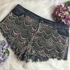 "BDG Mia low rise crochet cut off shorts Great condition. Size 30W. I love the front crochet detail. Dark denim. Measurements when laid flat: 17""waist, 10.5"" rise, 2"" inseam.  no trades BDG Shorts Jean Shorts"