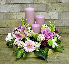 Really pretty colours in a small arrangement, but personally would change the wicker spheres.