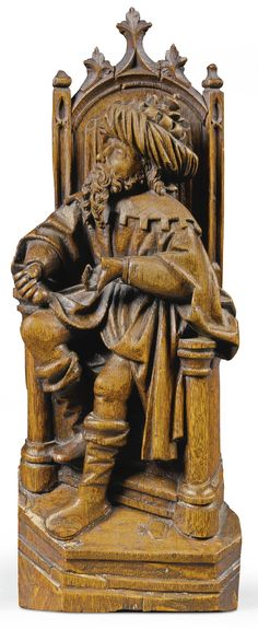 NETHERLANDISH, ANTWERP, EARLY 16TH CENTURY PONTIUS PILATE ENTHRONED stamped with the Antwerp hand mark on the base oak 42.5cm., 16¾in.