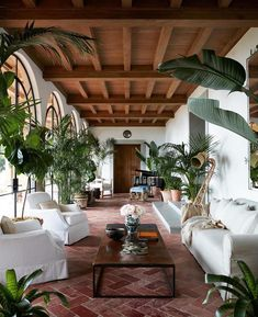 Beautiful estate in Montecito featured in the March edition of @archdigest! I love the architectural details in their sunroom, the tropical plants and white slipcovers! Enjoy today my sweet friends! ⚜ #frenchinfluence #interiordesignideas #interiordesign #exterior #exteriordesign #frenchcountry #frenchstyle #architecture #architectural #details #hardscape #landscape #wood #nature #plants #trees #charming #beautiful #inspiration #ceiling #floor #arched #doors #white #green #tropical