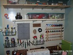 from Delightful Order: Boxes, Bins, Baskets and More Storage--peg board in the craft room