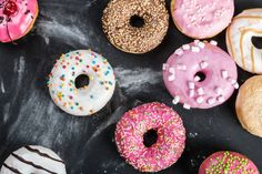 different colored donuts with different fillings on a black