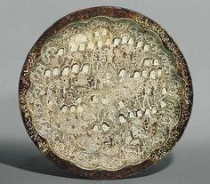 Dish depicting a wedding procession, Seljuq period (1040–1196), first quarter of 13th century  Iran, Kashan  Stonepaste; molded, luster-painted on opaque white glaze