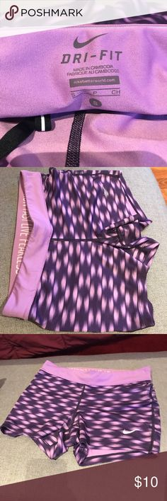 Nike short spandex workout shorts Purple and pink Nike workout shorts. Small zip pocket in back. Only worn twice. Nike Shorts