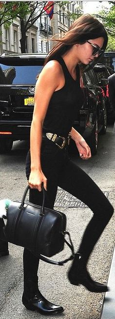 Who made Kendall Jenner's belt, black leather handbag, ankle boots, and key chain?