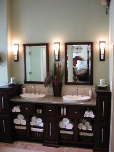 Master Bath- I like the openness and dark cabinetry and granite countertops and double mirrors