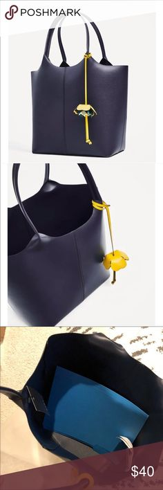 New cute Navy Zara Tote shoulder bag! Cute navy, with removable flower chain ROOMY bag - fits more than just a folder! What every female needs..a roomy shopper/Tote Bag! One of my favs! Great for work / school! Brand new with tags! Comes with Zara dustbag! Pet free and smoke free home Zara Bags Totes