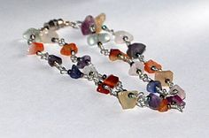 Anklet multi colored agates wire wrapped. $15.00, via Etsy.