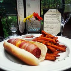 Texas Tommy - Beef Hot Dog wrapped in Bacon and stuffed with Cheddar Cheese & Jalapenos, served with Sweet Potato Fries - $10