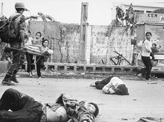 Civilians caught in the middle of deadly fighting during the Vietnam War being directed by a South Vietnamese soldier.