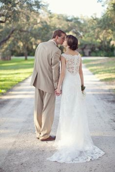 Love the back of her dress and his suit :)