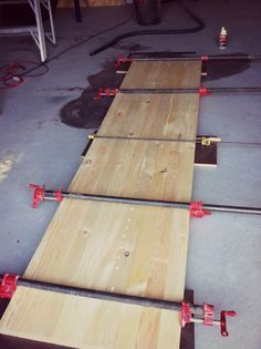 DIY Butcher Block Countertops. This site shows you how to cut the wood, glue and clamp it to make the board.
