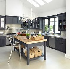 I love everything about this kitchen. The white chandys, the grey cabinets, the shiny silver stool.