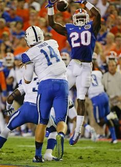 Florida defensive back Marcus Maye (20) knocks down a pass thrown by Kentucky quarterback Patrick Towles (14) during the first half of an NCAA college football game in Gainesville, Fla., Saturday, Sept. 13, 2014.