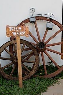 Wagon wheels and signs for various booths, entrances, etc