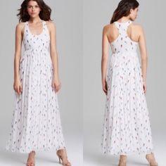Rebecca Minkoff Sunita bird-print maxi dress. Us 2 Scoop neckline. Sleeveless racer back. Skirt falls to floor. Polyester. Dry clean. Skirt falls to floor Rebecca Minkoff Dresses Maxi