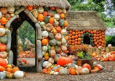 Hous with a facade made of pumpkins and gourds with a thatched roof.