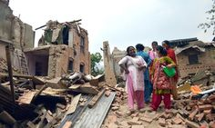 Exactly one year ago, a 7.8-magnitude earthquake hit Nepal killing thousands and injuring many more. Just one week after the quake, a group of women stand over wreckage in Sankhu.