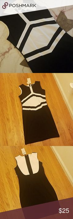 "Modern Black & White Stretch Dress. Modern Black & White Stretch Dress. Large but fits like medium. Some stretch. Bust laying flat from armpit to armpit to armpit: 16"" Waist laying flat: 14"" Length from shoulder to hem: 35"" R.J. Story Dresses Midi"