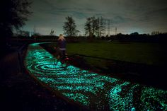 "Vincent Van Gogh's hometown of Eindhoven pays him a tribute with this glowing bike path interpretation of his ""Starry Night"" painting. Artist Daan Roosegaarde relied on solar-powered LED lights. Learn more w/ NPR! (photo: Studio Roosegaarde)"