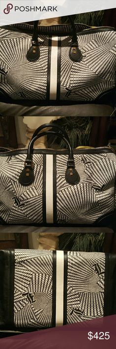 """L.A.M.B. """"Samburu"""" Eton Duffel Bag ~Fall 2008 Signature Collection~  EUC. No rips, stains, holes, tears, color transfer or odor. Beautiful bag but it's too big for me. Wasn't expecting it to be this big. Need something smaller for the gym. Great for traveling.  Print PVC duffel bag with striped banding at front & back & leather trim at edges. Gold hardware. Double rolled handles & detachable shoulder strap. 19"""" main compartment zipper. Lined interior features 10"""" zipper pocket & 5 pockets…"""