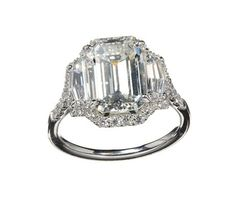 Norman Silverman platinum engagement ring featuring a 4.02 carat emerald-cut diamond framed by modified shield-cut diamonds surrounded by a custom-fitted halo of round brilliant diamonds #TheFacet