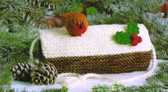 """From Jean Greenhowe's 'Christmas Special' collection comes this sweet little muff. Probably a bit old fashioned for some it is the sort of thing a young girl might be happy to get at Christmas and for her dressing up box.It is knitted with three strands of DK wool in the main and is about 20cm/8"""" long. Designed and published by Jean Greenhowe Designs in 1991."""