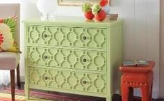 The textured wood design makes this dresser pop when painted pale green.