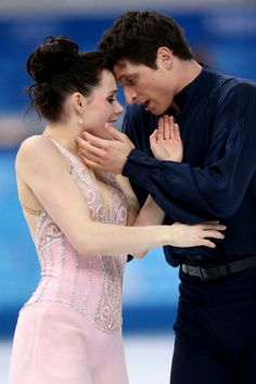 Tessa Virtue and Scott Moir of Canada compete in the Figure Skating Ice Dance Free Dance on Day 10 of the Sochi 2014 Winter Olympics at Iceberg Skating Palace on February 2014 in Sochi, Russia. Get premium, high resolution news photos at Getty Images Virtue And Moir, Tessa Virtue Scott Moir, Ice Dance Dresses, Skating Dresses, Olympic Ice Skating, Roller Skating, Tessa And Scott, Winter Olympics, Olympic Games