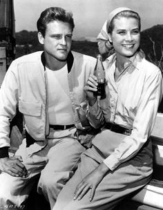 . John Ericson and Grace Kelly enjoy a lull in the filming of Green Fire (1954)…