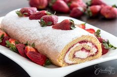 Strawberry Swiss Roll. This is a delicate refreshing cake perfect for warm days of spring and summer. A vanilla sponge cake is filled with fresh homemade strawberry jam and vanilla flavored cream cheese frosting, served with fresh strawberries, such a wonderful dessert to prepare for your family and guests.