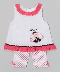 Little fashion bugs will look super-duper sweet in this light and airy top and leggings duo. Bitty bows, polka dots and ruffles add to the fun, while back buttons on the top and easy-on elastic on the bottoms make for easy changing and a relaxed fit that's all-day comfy.
