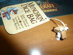 Ice age Scrat phone strap and a paper package from a card game into a bookmark