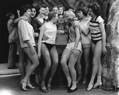 Kenneth Connor and 12 women, My take on this picture: I was two years old when this ventage photo was taken.I had to laugh over the either short ankle length stockings or socks and high heels and flat shoes!